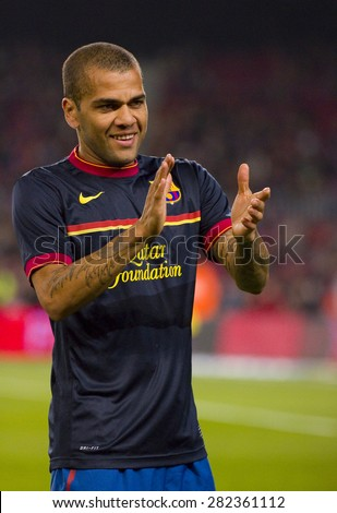 BARCELONA - JANUARY 4: Dani Alves of Barcelona in action during the Spanish Cup match between FC Barcelona and Osasuna, final score 4 - 0, on January 4, 2012 in Camp Nou stadium, Barcelona, Spain. - stock photo