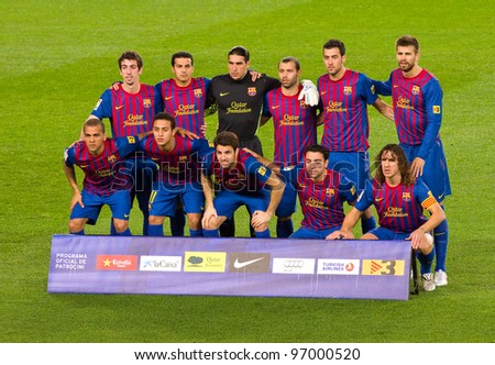 BARCELONA - JANUARY 4: FC Barcelona players before the Spanish Cup match between FC Barcelona and Osasuna, final score 4 - 0, on January 4, 2012 in Camp Nou stadium, Barcelona, Spain. - stock photo