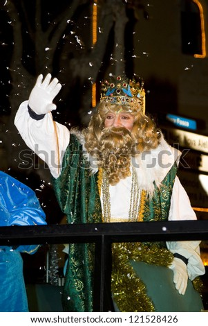 BARCELONA - JANUARY 5: Gaspar King at the Biblical Magi Three Kings parade, who give toys to the children. Is a traditional spanish celebration. January 5, 2012 in Alella, Barcelona, Spain.