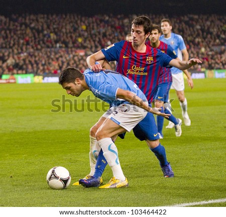 BARCELONA - JANUARY 4: Isaac Cuenca (R) of Barcelona in action during the Spanish Cup match between FC Barcelona and Osasuna, final score 4-0, on January 4, 2012 in Camp Nou stadium, Barcelona, Spain.