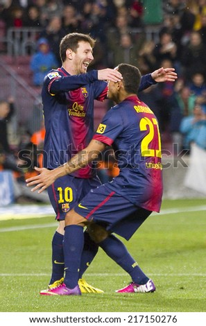 BARCELONA - JANUARY 27: Leo Messi of FCB (L) celebrating his goal at the Spanish League match between FC Barcelona and Osasuna, final score 5 - 1, on January 27, 2013, in Barcelona, Spain. - stock photo