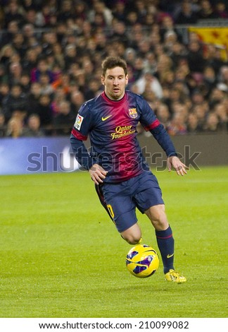 BARCELONA - JANUARY 6: Lionel Messi (10) in action during the Spanish League match between FC Barcelona and RCD Espanyol, 4 - 0, on January 6, 2013, in Barcelona, Spain. - stock photo