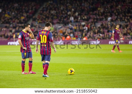 BARCELONA - JANUARY 26: Lionel Messi (10) of FCB in action at Spanish league match between FC Barcelona and Malaga CF, final score 3-0, on January 26, 2014, in Barcelona, Spain. - stock photo