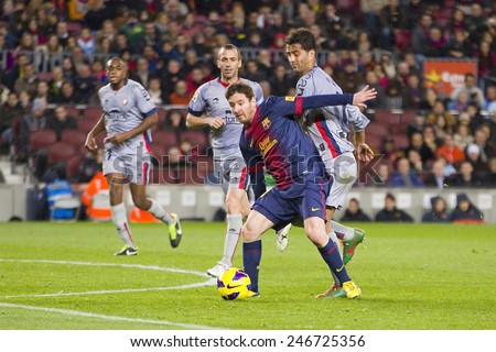 BARCELONA - JANUARY 27: Lionel Messi of FCB in action at the Spanish League match between FC Barcelona and Osasuna, final score 5 - 1, on January 27, 2013, in Barcelona, Spain. - stock photo