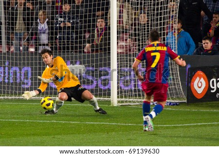 BARCELONA - JANUARY 12: Nou Camp football stadium, soccer Spanish Cup: FC Barcelona - Real Betis, 5 - 0. In the picture, David Villa shooting a goal. January 12, 2011 in Barcelona (Spain). - stock photo