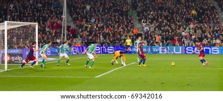 BARCELONA - JANUARY 12: Nou Camp football stadium, soccer Spanish Cup: FC Barcelona - Real Betis, 5 - 0. In the picture, Pedro (R) shooting a goal. January 12, 2011 in Barcelona (Spain). - stock photo