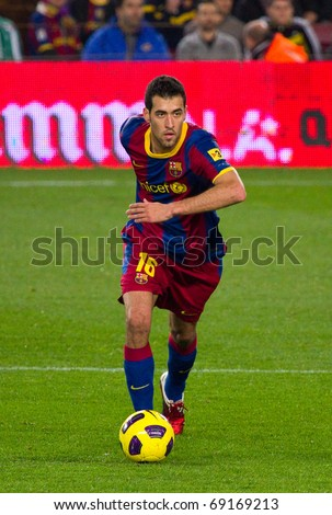 BARCELONA - JANUARY 12: Nou Camp football stadium, soccer Spanish Cup match: FC Barcelona - Real Betis, 5 - 0. In the picture, Sergio Busquets in action. January 12, 2011 in Barcelona (Spain). - stock photo