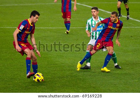 BARCELONA - JANUARY 12: Nou Camp football stadium, soccer Spanish Cup match: FC Barcelona - Real Betis, 5 - 0. In the picture, Sergio Busquets (left) in action. January 12, 2011 in Barcelona (Spain).