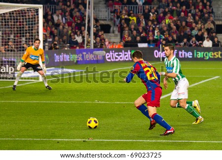 BARCELONA - JANUARY 12: Nou Camp soccer stadium, Spanish Cup match: FC Barcelona - Real Betis, 5 - 0. In the picture, Afellay in action. January 12, 2011 in Barcelona (Spain). - stock photo
