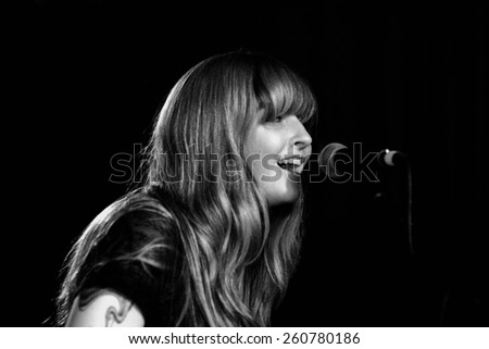 BARCELONA - JUL 27: Katy Goodman, from Vivian Girls, performs at Discotheque Razzmatazz on July 27, 2010 in Barcelona, Spain. - stock photo