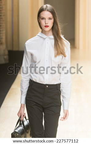 BARCELONA - JULY 01: a model walks on the Menchen Tomas catwalk during the 080 Barcelona Fashion runway Spring/Summer 2015 on July 01, 2014 in Barcelona, Spain.  - stock photo