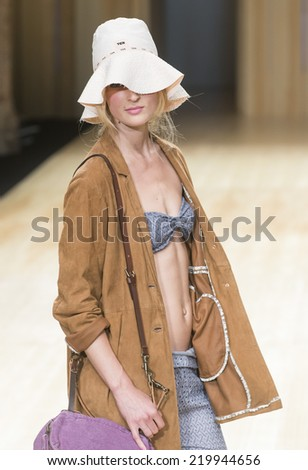 BARCELONA - JULY 01: a model walks on the TCN catwalk during the 080 Barcelona Fashion runway Spring/Summer 2015 on July 01, 2014 in Barcelona, Spain.