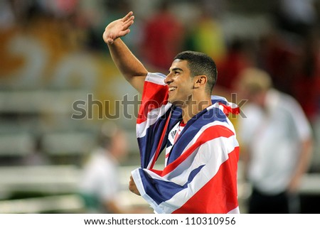 BARCELONA - JULY, 11: Adam Gemili of Great Britain celebrate gold on 100 meters of the 20th World Junior Athletics Championships at the Olympic Stadium on July 11, 2012 in Barcelona, Spain - stock photo
