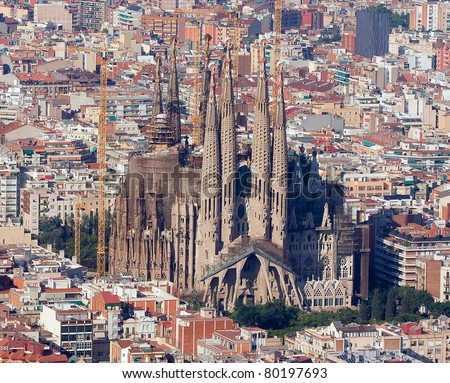BARCELONA - JULY 7: Aerial view of Sagrada Familia on July 7, 2010 in Barcelona, Spain. This is before the visit of Pope Benedict XVI to consecrate this cathedral. It is designed by Catalan architect Antoni Gaudi. - stock photo