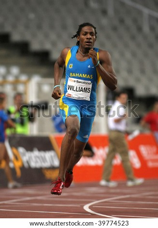 BARCELONA JULY 25: Bahamian athlete Andrae Williams runs to win his men's 400 meters hurdles at the Meeting Ciutat de Barcelona athletics event on July 25, 2009 in Barcelona, Spain. - stock photo