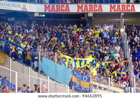 BARCELONA - JULY 27: Boca supporters during the Ciutat de Barcelona Trophy final match between RCD Espanyol and Boca Juniors, final score 3 - 1, on July 27, 2011 in Cornella stadium, Barcelona, Spain. - stock photo