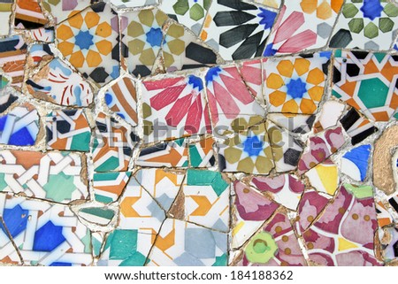BARCELONA - JULY 28: Ceramic mosaics of Park Guell on July 28, 2009 in Barcelona, Spain. Original work designed by the Catalan architect Antoni Gaudi (1852 -Â?Â? 1926)  and built in the years 1900 to 1914 - stock photo