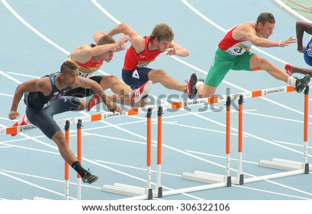 BARCELONA - JULY, 10: Competitors of 110 meters hurdles during the 20th World Junior Athletics Championships at the Olympic Stadium on July 10, 2012 in Barcelona, Spain - stock photo