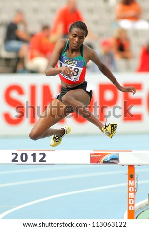BARCELONA - JULY, 10: Daisy Jepkemei of Kenia during 3000 Metres Steeplechase event of the 20th World Junior Athletics Championships at the Olympic Stadium on July 10, 2012 in Barcelona, Spain - stock photo