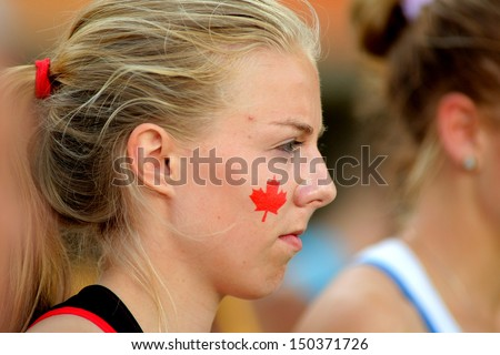 BARCELONA - JULY, 14: Devan Wiebe of Canada before 4X400 Relay event of the 20th World Junior Athletics Championships at the Olympic Stadium on July 14, 2012 in Barcelona, Spain - stock photo