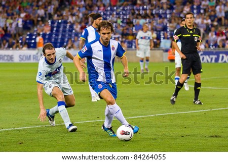 BARCELONA - JULY 27: Joan Verdu (11) in action during the Ciutat de Barcelona Trophy final match between RCD Espanyol and Boca Juniors, 3 - 1, on July 27, 2010 in Cornella stadium, Barcelona, Spain. - stock photo