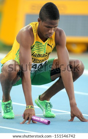 BARCELONA - JULY, 14: Shavon Barnes of Jamaica competes on 4X400 Relay of the 20th World Junior Athletics Championships at the Olympic Stadium on July 14, 2012 in Barcelona, Spain - stock photo