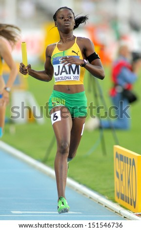 BARCELONA - JULY, 14: Shericka Jackson of Jamaica competes on 4X400 Relay of the 20th World Junior Athletics Championships at the Olympic Stadium on July 14, 2012 in Barcelona, Spain - stock photo
