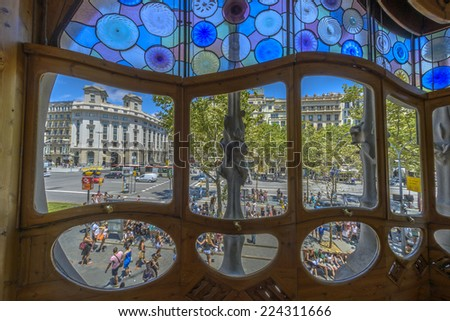 Barcelona - July 16: Tourists outside the famous casa Battlo building designed by Antonio Gaudi on July 16, 2014 in Barcelona, Spain. - stock photo