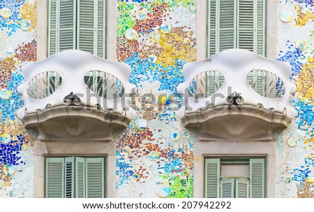 BARCELONA - JULY 29: two balconies of the Casa Batllo facade designed by Antoni Gaudi on July 29, 2014, Barcelona, Spain.  - stock photo