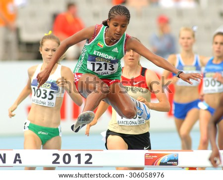 BARCELONA - JULY, 10: Yeabsira Bitew of Ethiopia in action on 3000 meters Steeplechase of the 20th World Junior Athletics Championships at the Olympic Stadium on July 10, 2012 in Barcelona, Spain - stock photo