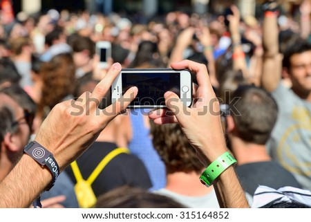 BARCELONA - JUN 18: A man takes a picture with his smartphone  in a concert at Sonar Festival on June 18, 2015 in Barcelona, Spain. - stock photo