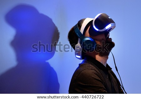 BARCELONA - JUN 16: A man tries the Playstation VR (Virtual Reality) glasses at Sonar Festival on June 16, 2016 in Barcelona, Spain.