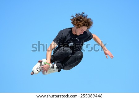 BARCELONA - JUN 28: A professional skater at the Inline skating jumps competition at LKXA Extreme Sports Barcelona Games on June 28, 2014 in Barcelona, Spain.