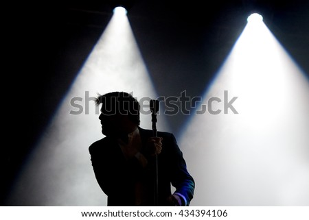 BARCELONA - JUN 2: Silhouette of the singer of LCD Soundsystem (band) at Primavera Sound 2016 Festival on June 2, 2016 in Barcelona, Spain.