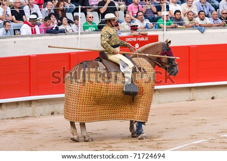 """BARCELONA - JUNE 6: Bullfight, typical Spanish tradition. In the picture, a """"Picador"""", horsemen in a Spanish bullfight who jabs the bull with a lance June 6, 2010 in Barcelona (Spain). - stock photo"""