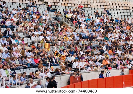 BARCELONA - JUNE 6: Bullfighting, typical Spanish tradition where a bullfighter kills a bull. In the picture, some supporters. June 6, 2010 in Barcelona (Spain). - stock photo