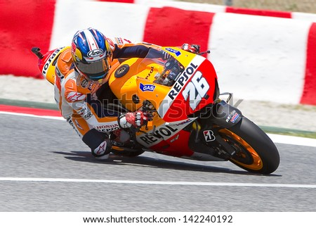 BARCELONA - JUNE 14: Dani Pedrosa of Honda team racing at Free Practice Session of MotoGP Grand Prix of Catalunya, on June 14, 2013 in Barcelona, Spain. Valentino Rossi posts the fastest time.