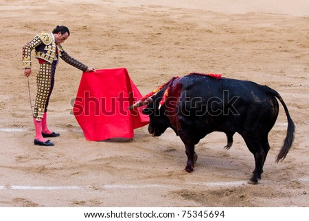 BARCELONA - JUNE 6: Finito de Cordoba in action during a bullfighting, typical Spanish tradition where a bullfighter kills a bull. June 6, 2010 in Barcelona, Spain. - stock photo