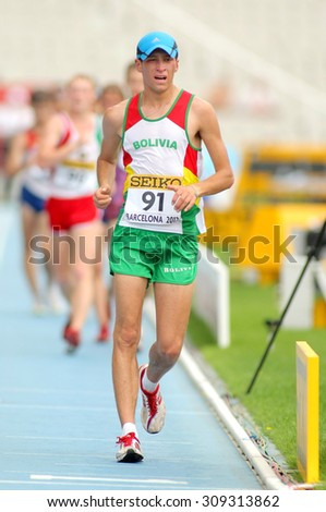 BARCELONA - JUNE, 13: Marco Antonio Rodriguez of Bolivia during 10000 metres walk event of of the 20th World Junior Athletics Championships at the Olympic Stadium on July 13, 2012 in Barcelona, Spain - stock photo