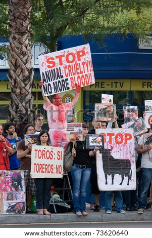 "BARCELONA - JUNE 6: Protesters in an  Anti-Bullfighting demonstration on June 6, 2010 in Barcelona (Spain). ""Corrida"" (bullfighting) of bulls, typical Spanish tradition. - stock photo"