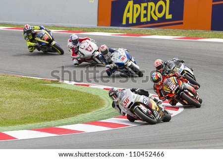 BARCELONA - JUNE 3: Some motorcycle riders compete at the race of Moto2 Grand Prix of Catalunya, on June 3, 2012 in Barcelona, Spain. - stock photo