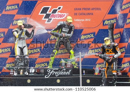 BARCELONA - JUNE 3: Thomas Luthi (2nd), Andrea Iannone (1st) and Marc Marquez (3rd) (L-R) in the podium after the race of Moto 2 Grand Prix of Catalunya, on June 3, 2012 in Barcelona, Spain. - stock photo