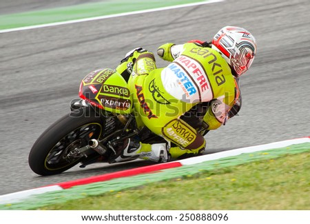 BARCELONA - JUNE 5: Unidentified rider racing at Moto 125 Grand Prix of Catalunya, on June 5, 2011 in Barcelona, Spain. - stock photo
