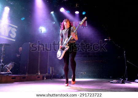 BARCELONA - MAR 18: Charlotte Cooper, guitar player of The Subways (rock band), performs at Bikini stage on March 18, 2015 in Barcelona, Spain. - stock photo