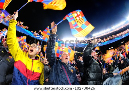 BARCELONA - MAR 12: Fans at the Camp Nou Stadium supporting with flags in the match between Futbol Club Barcelona and Manchester City of the Champions League on March 12, 2014 in Barcelona, Spain. - stock photo