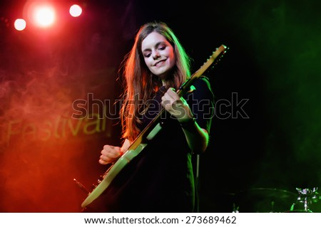 BARCELONA - MAR 4: The female singer and guitar player of Nadadora (band) performs at Salamandra stage on March 4, 2011 in Barcelona, Spain. - stock photo