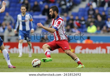 BARCELONA - MARCH, 14: Arda Turan of Atletico Madrid during a Spanish League match against RCD Espanyol at the Estadi Cornella on March 14, 2015 in Barcelona, Spain - stock photo