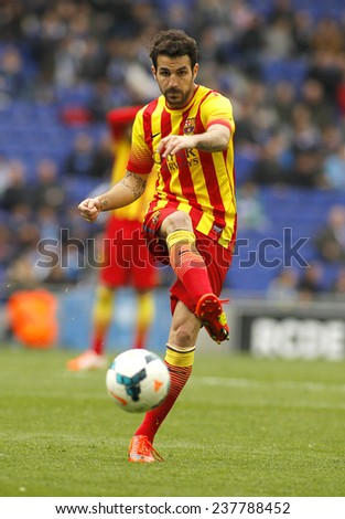 BARCELONA - MARCH, 29: Cesc Fabregas of FC Barcelona in action during a Spanish League match against RCD Espanyol at the Estadi Cornella on March 29, 2014 in Barcelona, Spain - stock photo