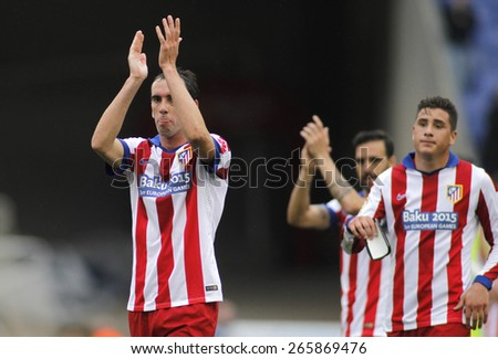 BARCELONA - MARCH, 14: Diego Godin of Atletico Madrid clapping supporters after of Spanish League match against RCD Espanyol at the Estadi Cornella on March 14, 2015 in Barcelona, Spain - stock photo