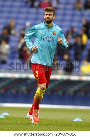 BARCELONA - MARCH, 29: Gerard Pique of FC Barcelona during the Spanish League match between Espanyol and FC Barcelona at the Estadi Cornella on March 29, 2014 in Barcelona, Spain - stock photo